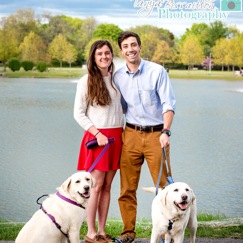 scenic photos of a couple with their labador retriever dogs